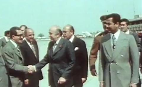 رفتار توهین آمیز صدام حسین با هویدا