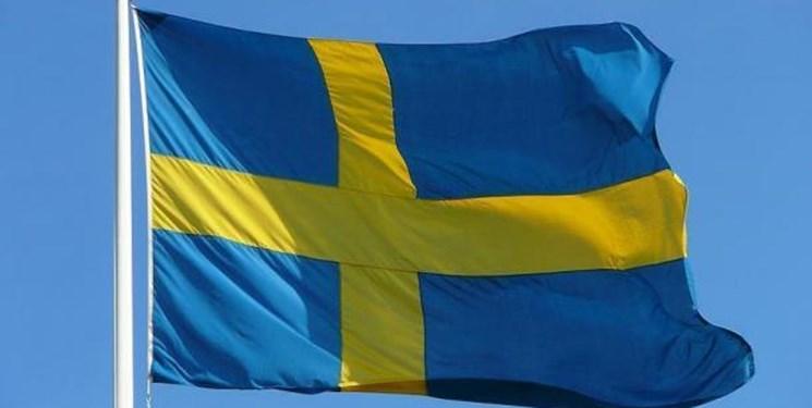 اهانت به قرآن کریم در برابر ساختمان پارلمان سوئد