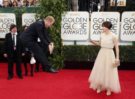 پرش عجیب جس تایلر فرگوسن و واکنش زویی کلر دشانل بر روی فرش قرمز هفتادویکمین مراسم اهدای جوایز گلدن گلوب در بورلی هیلز کالیفرنیا!/reuters
