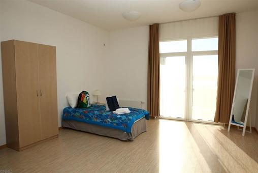 یک اتاق آماده پذیرائی از قهرمانان المپیک تیمها واقع در دهکده المپیک