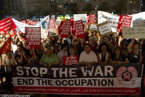 اعتراض یهودیان تل آویو به کشتار صهیونیستها+تصاویر